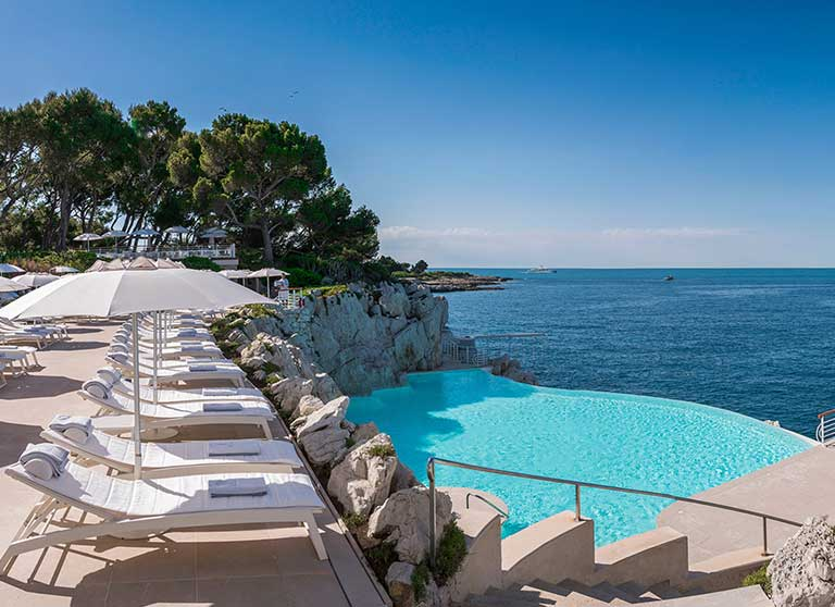 The infinity pool cut into the rock overlooking the sea at the Hotel du Cap-Eden-Roc in Antibes, France