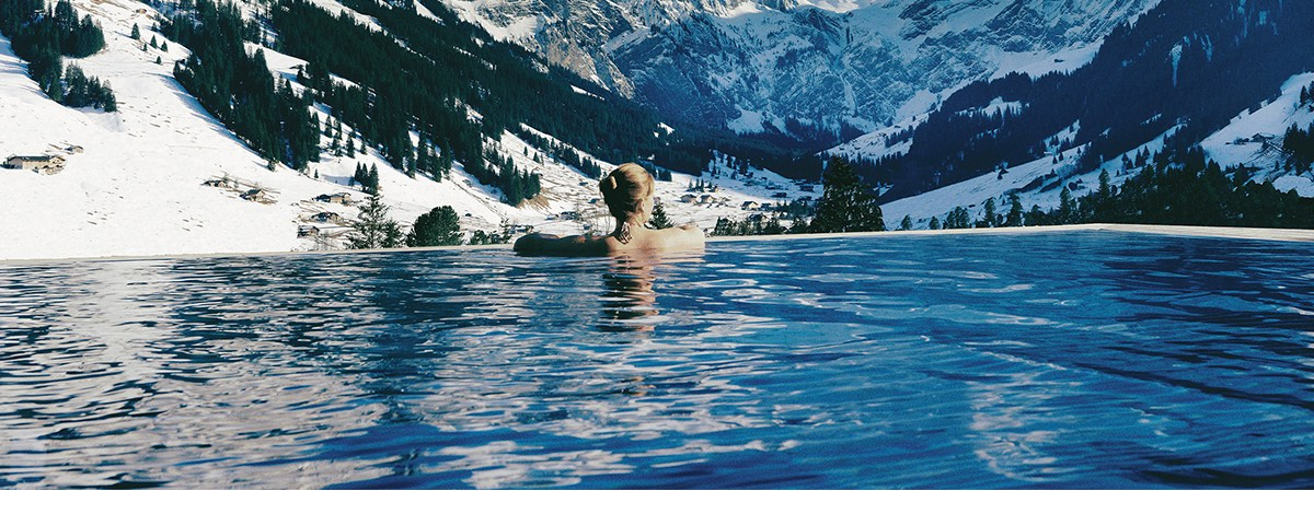 Views of the snow-topped Swiss Alps mountains from the outfoor pool at The Cambrian Hotel, Adelboden, Switzerland