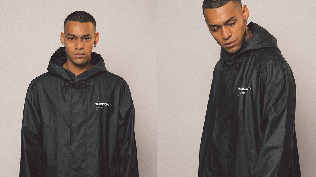 Male model wearing an Off-White 'quote' raincoat