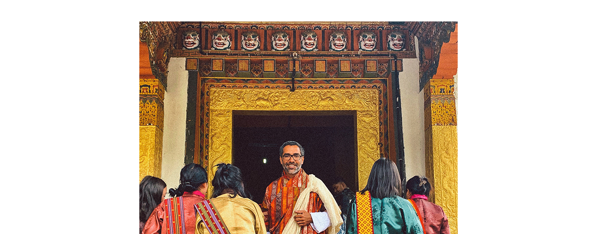 James Jayasundera, owner of Ampersands Travel, stood in an elaborate doorway in traditional dress