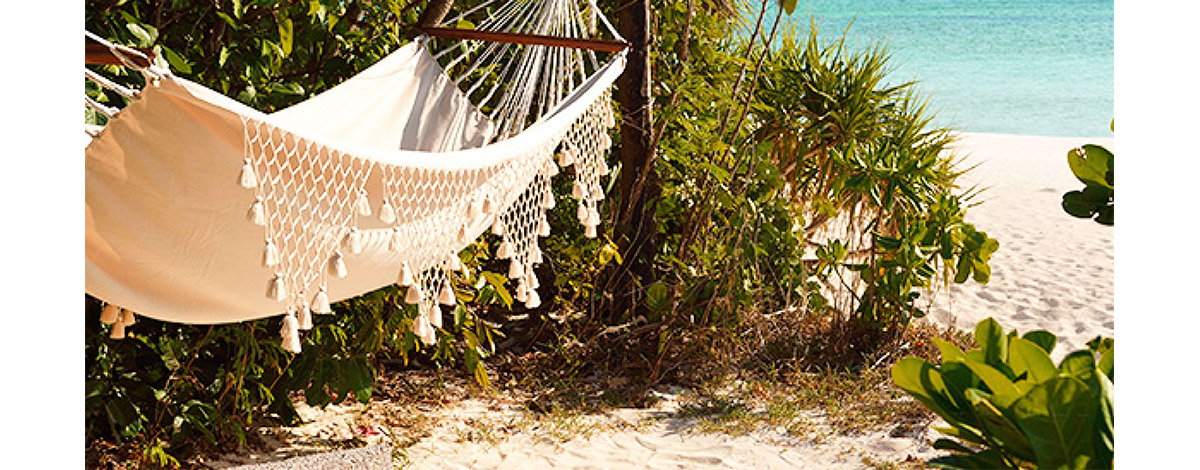 Hammock on the beach and a view of the sea Pamalican Island the Philippines