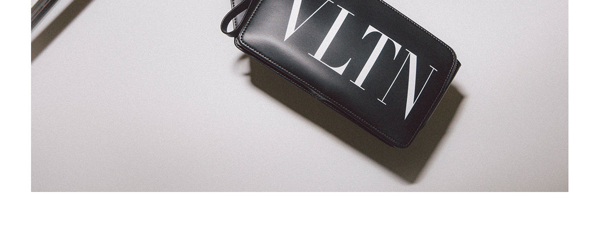 A black Valentino belt bag with a white VLTN logo