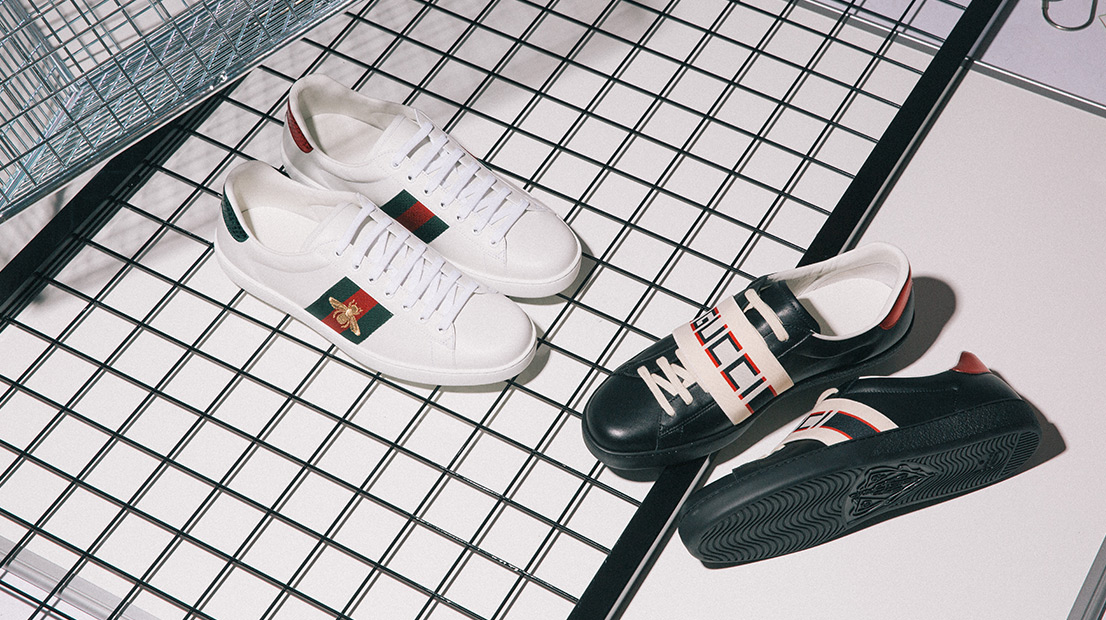 Gucci Ace trainers in white with the Gucci Web and embroidered bee and in black with a stripe