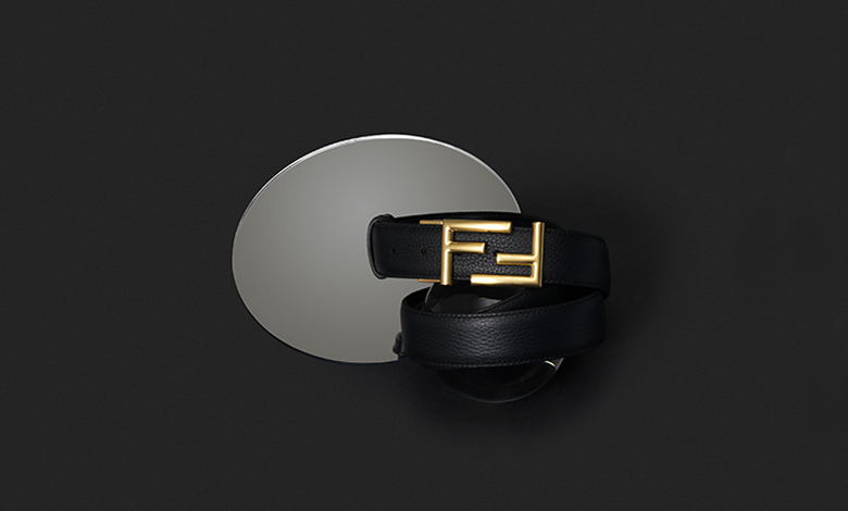 A black leather Fendi belt with a double F silver buckle
