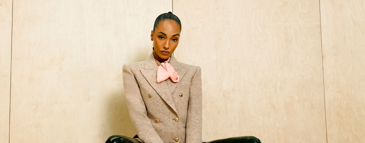 Jourdan Dunn wears Saint Laurent pink blazer, leather trousers, heels and bag