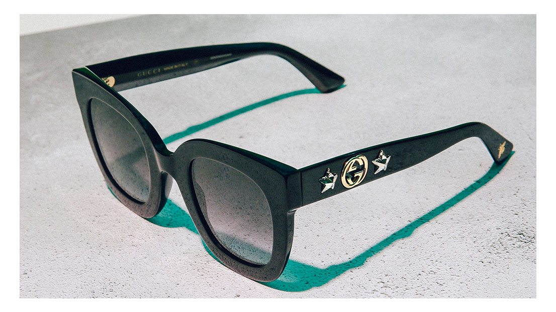 Black square Gucci sunglasses with double G logo and star embellishments on arm