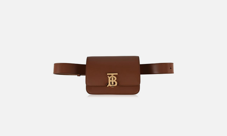 A tan leather Burberry belt bag with the new TB logo clasp