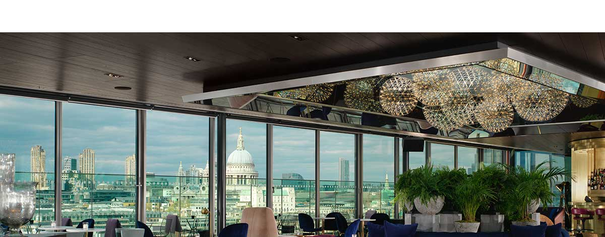 sundowners-at-the-rooftop-bar-at-RumpusRoom-Mondrian-Hotel-London