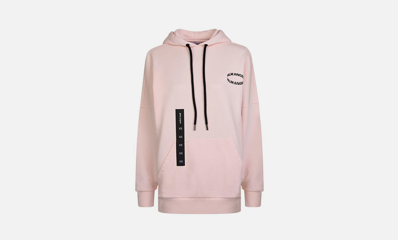 A pale pink Palm Angels hooded sweatshirt with black type, graphics and a logo on the back