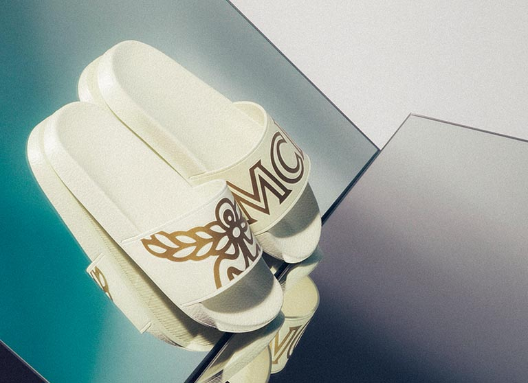 MCM white and gold logo sliders