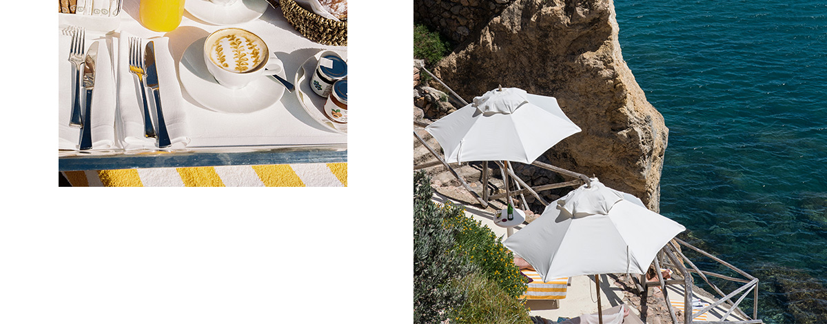A beautifully laid breakfast tray at Hotel Il Pellicano, set on a yellow and white striped towl, with a black and white printed newspaper, croissants, coffee and orange juice, and views out to sea from the rocky promontory