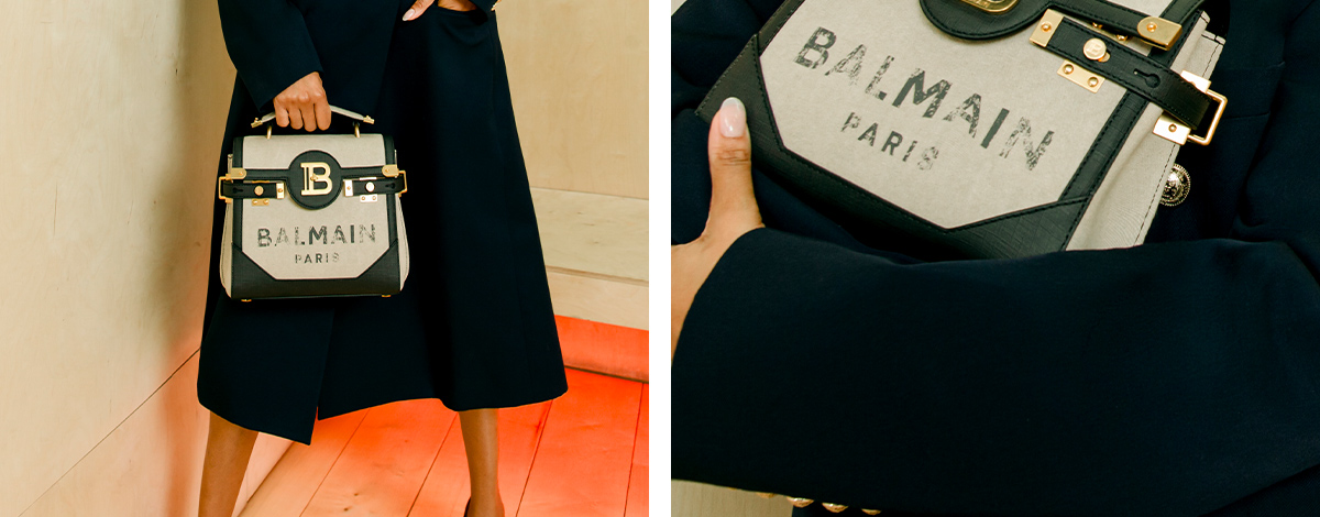 Jourdan Dunn wearing Balmain black coat and carrying Balmain B Bag