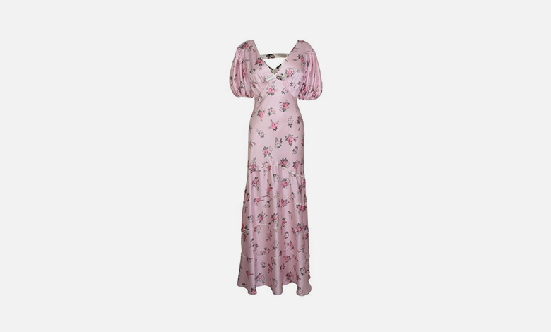A pink silky Love Shack Fancy dress with a floral print in a bias cut with puff sleeves
