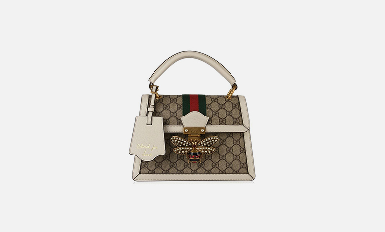 A Gucci Queen Margaret handbag with white leather handles and trim, beige Gucci GG canvas and red and green web stripe with a bee clasp encrusted with pearls