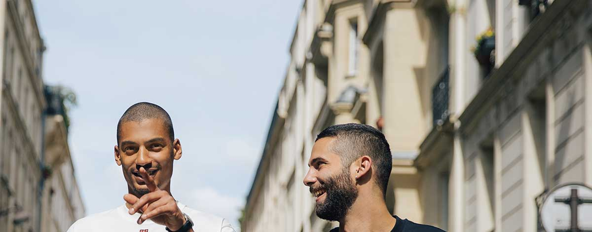 Jimmy Launay stood outside his cafe Rude Manners in Paris wearing Givenchy jeans, an Off-White checked shirt, a white T-shirt and Valentino cap