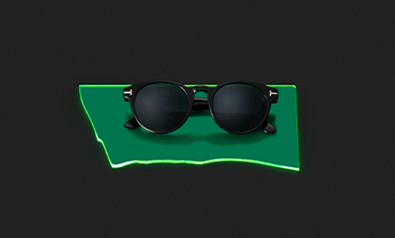 A pair of black Tom Ford Palmer sunglasses with gold T details