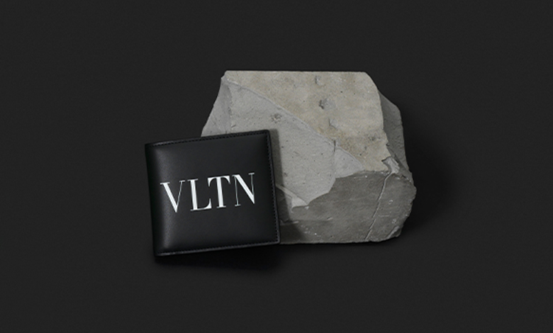 A black Valentino leather billfold wallet with VLTN logo
