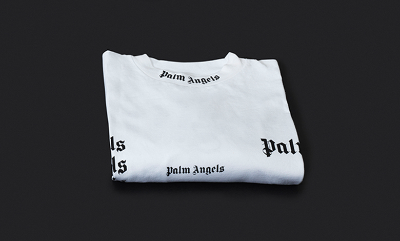 A white long sleeve Palm Angels Tee with all over Palm Angels logo graphic
