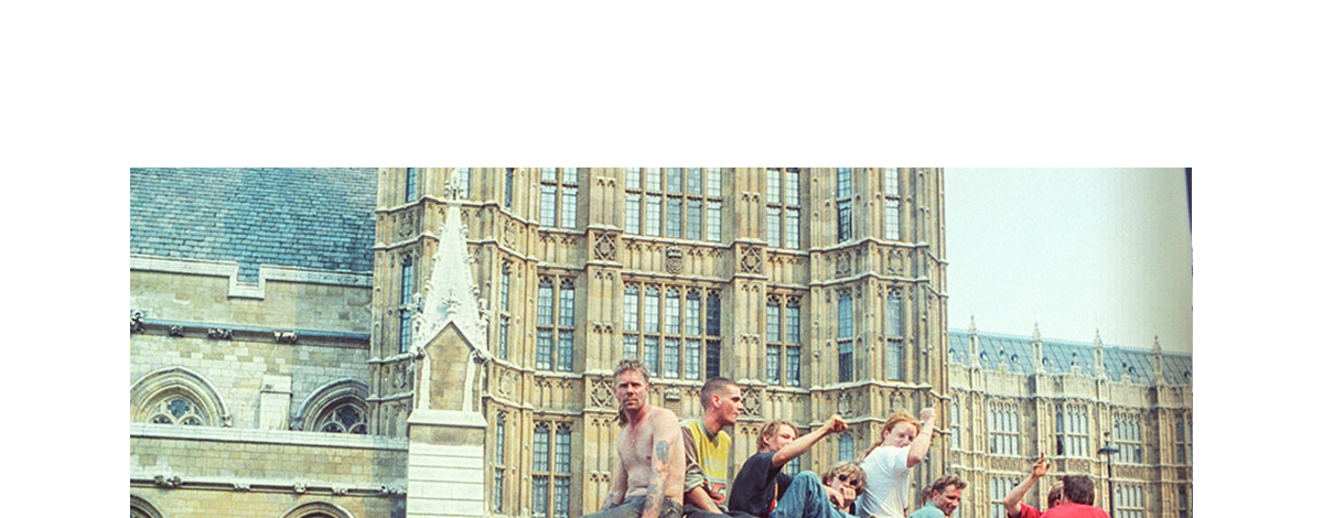 A 90s film photograph of protest ravers on a bus in Westminster
