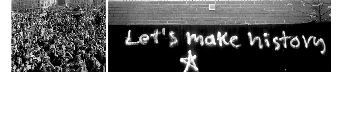 A black and white photograph from the 1990s of graffiti on a wall that says 'Let's Make History
