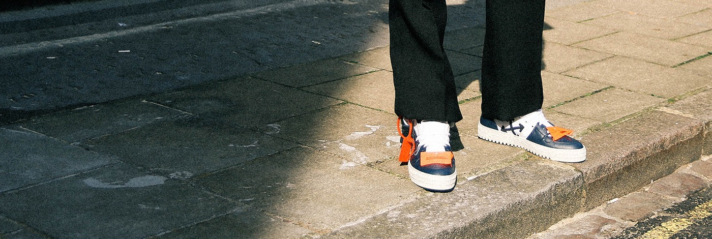 Model wearing Off-White court high top trainers