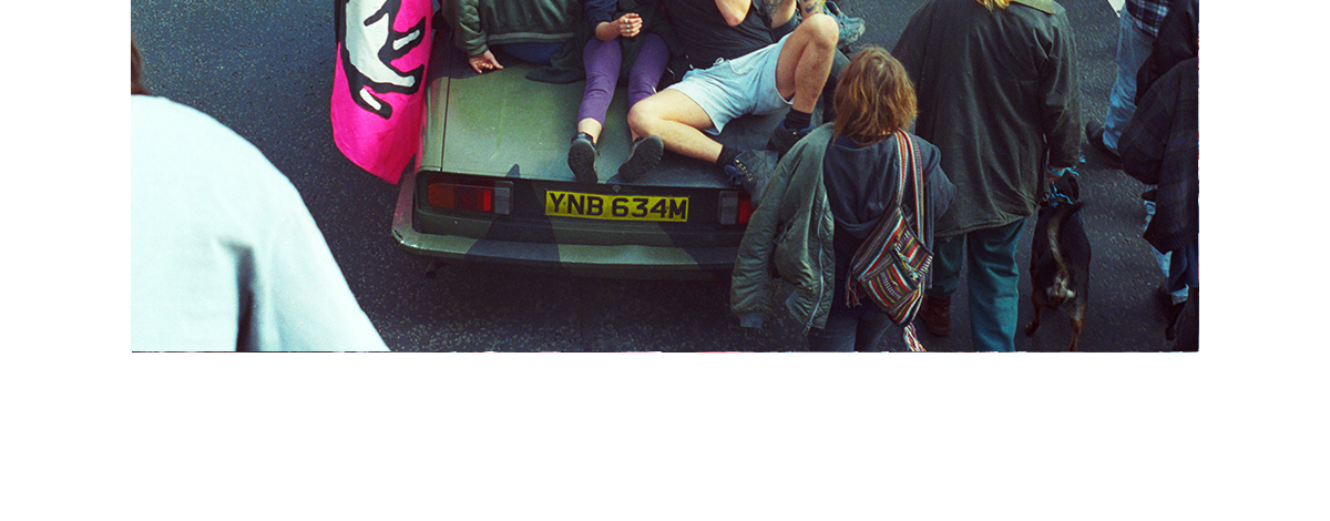 Rebellious ravers on the back of a car