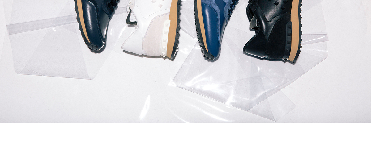 Four pairs of Valentino Rockstud trainers in blue, white and black
