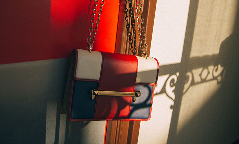 A photograph of a Valentino Uptown bag in red, white and blue leather