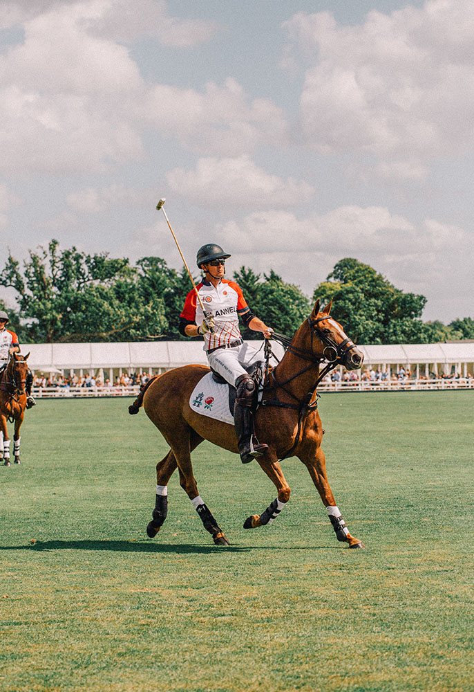 A FLANNELS ENGLAND polo team player on a horse at Windsor