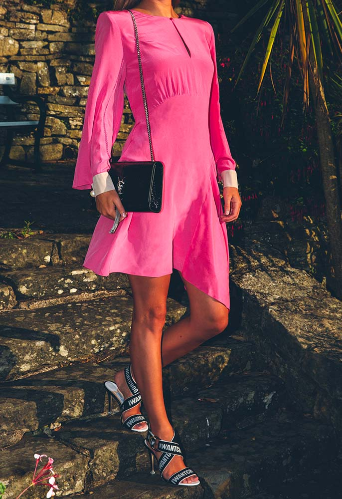 Model wearing a pink silk Fendi dress and black Saint Laurent Kate shoulder bag