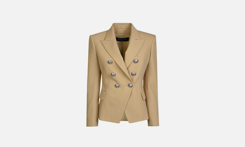 A beige Balmain double breasted blazer with sharp shoulders and silver Balmain buttons
