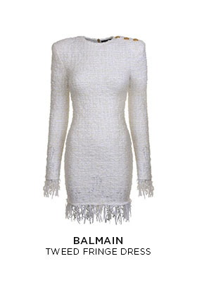 A white knit Balmain tweed fringe mini dress