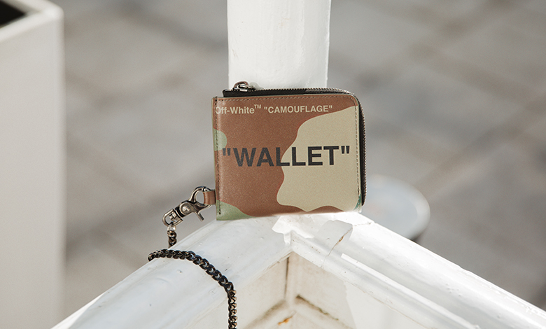 Off-White sqaure zip wallet in a camouflage print with a chain detail