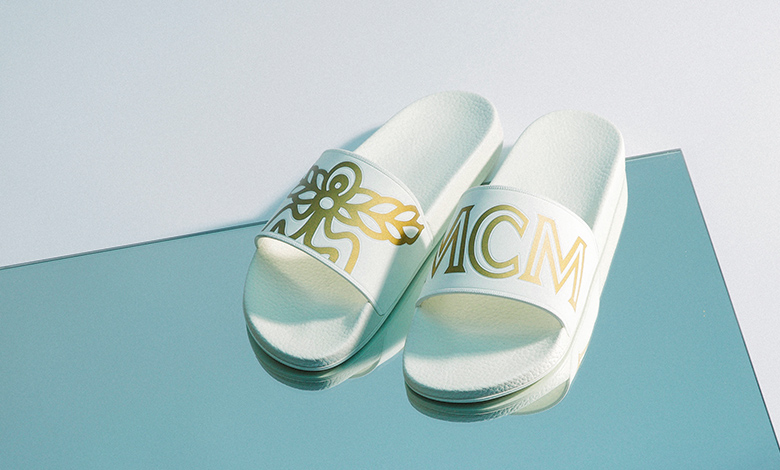 MCM Logo Rubber Sliders in white and gold