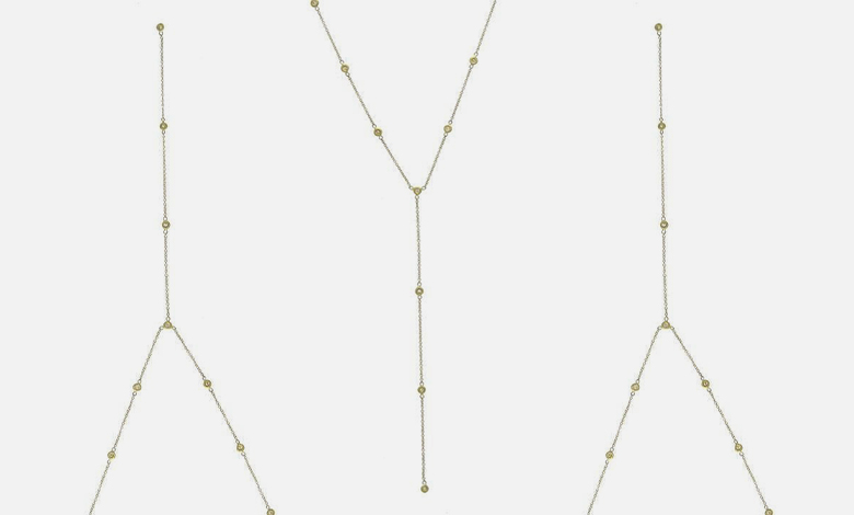 A Jacquie Aiche delicate gold chain necklace with small suspended gem stones at regular intervals and a chain pendant