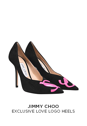 An e-commerce product image of a pair of black Jimmy Choo X FLANNELS limited edition heeled pumps with a slightly pointed toe and a pink Jimmy Choo JC logo on the toe