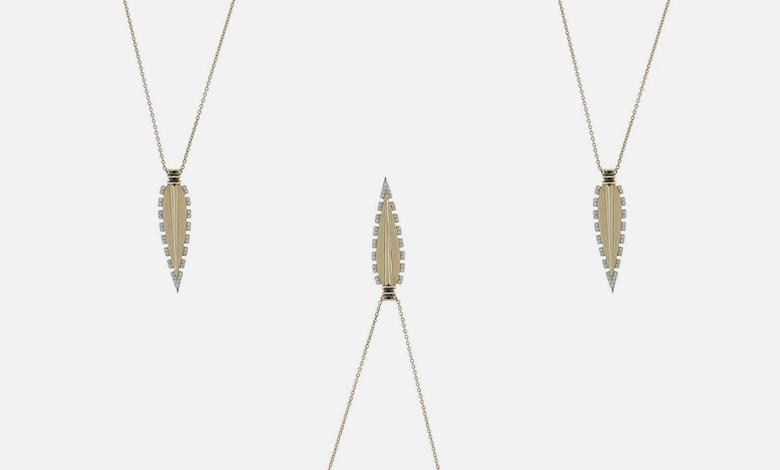 A Kismet by Milka delicate gold chain necklace with a gold feather pendant edged with white diamonds