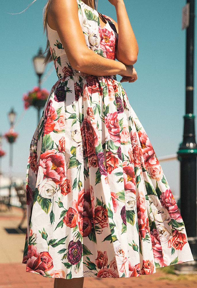 Model in the sun wearing a Dolce and Gabbana dress