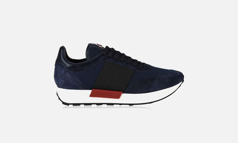 A Moncler Horace runner trainer with navy mesh side panels and vamp, a navy suede heel counter and black leather heel tab, black laces, a black stripe side panel and rubber Moncler logo on the toungue