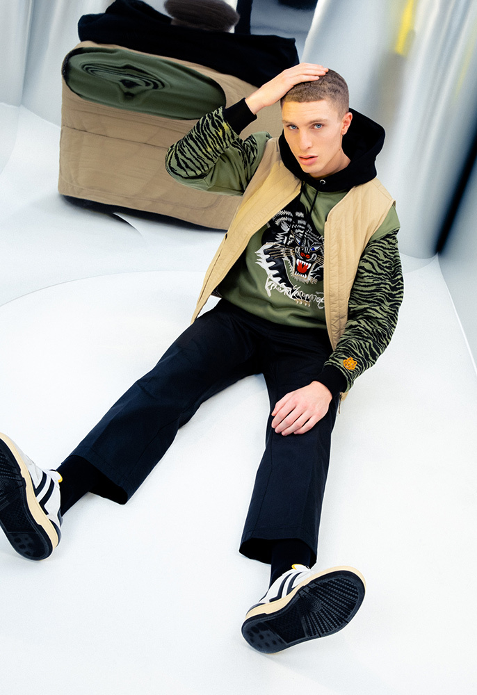 Photograph of male model in Kenzo hoodie, gilet and trousers and Lanvin trainers