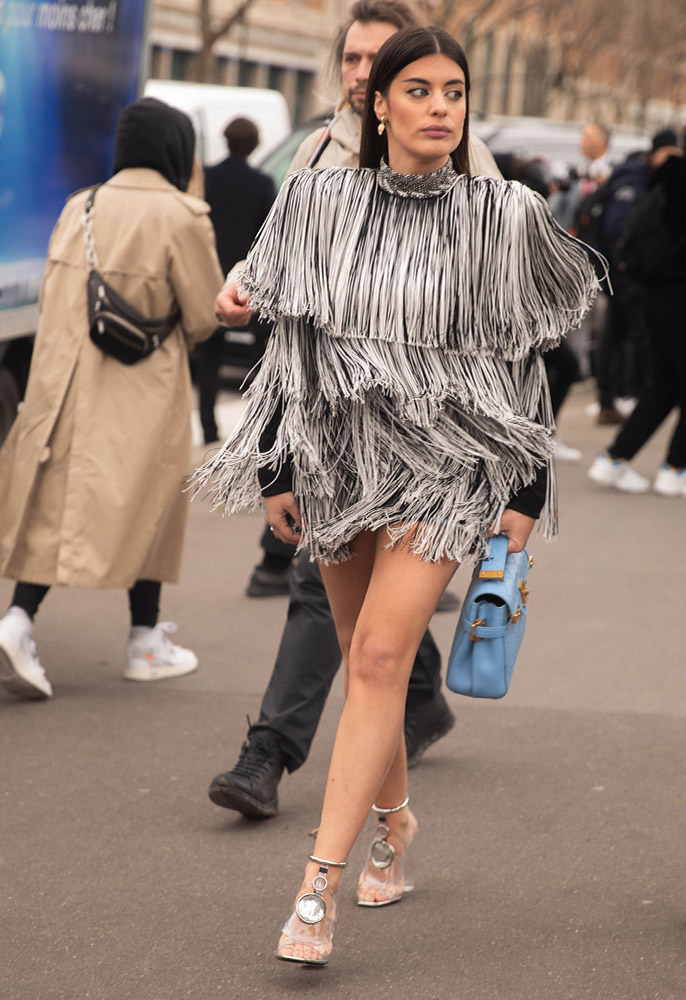 Photograph of PFW showgoer with a fringed dress in Paris