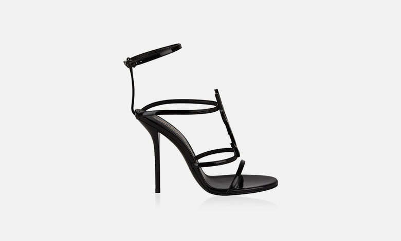Black strappy Saint Laurent Cassandra high heel sandals with a large metal YSL logo