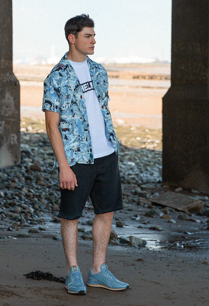 Model wearing Helmut Lang shorts and Tshirt, Lanvin mountain print short sleeved shirt