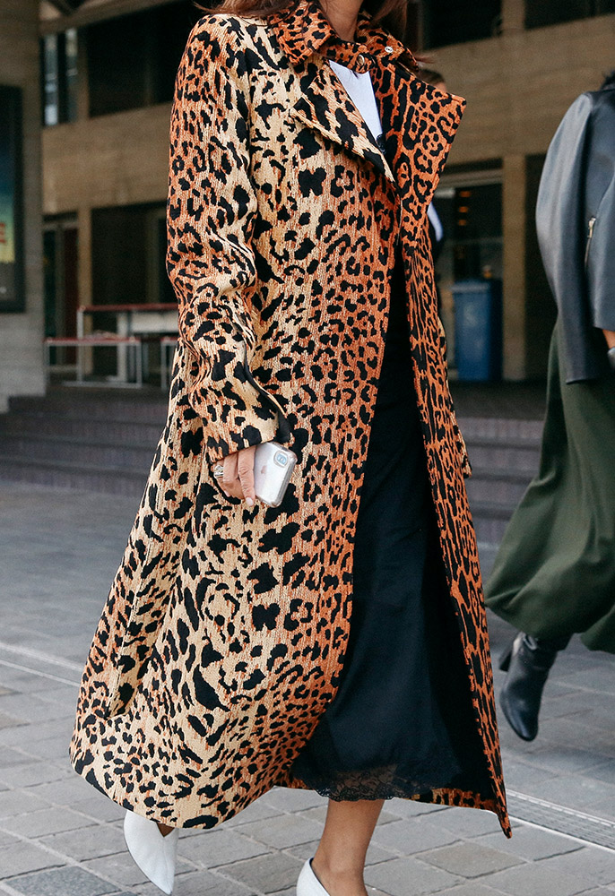 Street style photo of a woman wearing an animal print coat