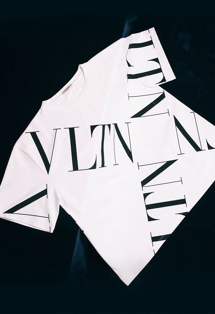 A black and white Valentino logo oversized T-shirt