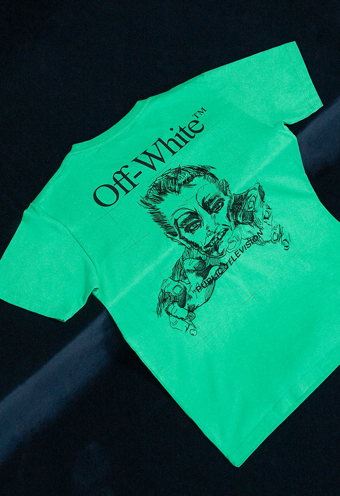 A green Off-White Mirk Artist T-shirt with black graphic logos and illustrations