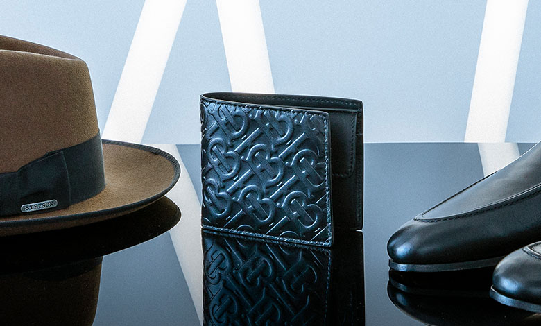 A Burberry monogram black leather bifold wallet