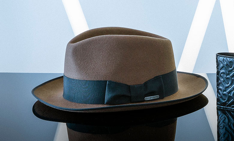 A classic camel Stetson fedora hat with a black trim