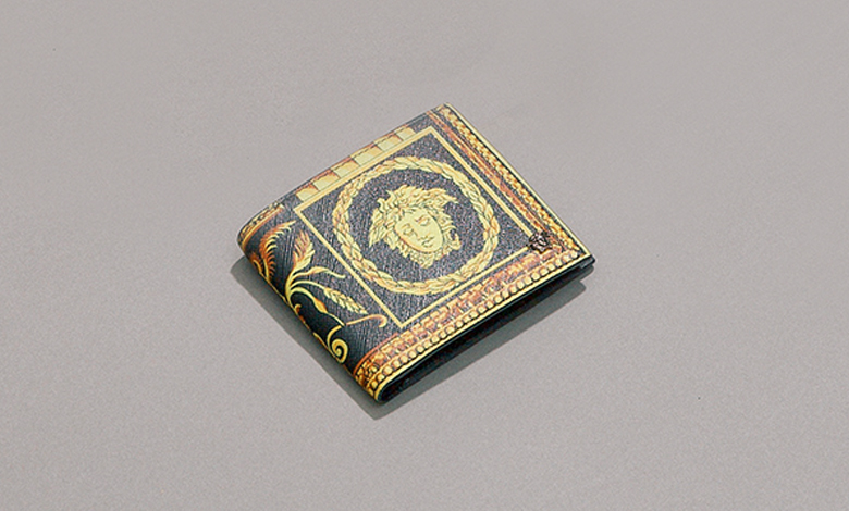Versace Cornici baroque printed wallet in black and yellow
