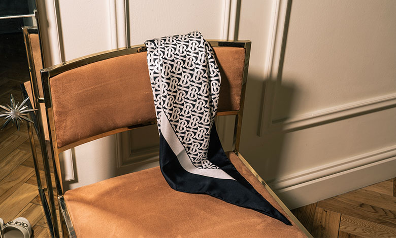 A silk printed Burberry scarf in black and white with the new logo